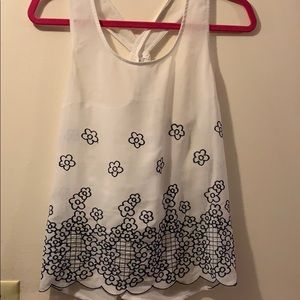Sheer white tank with blue flowers